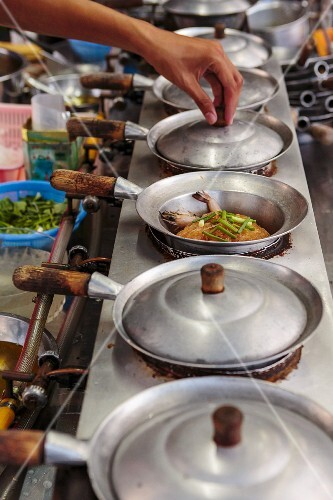 Fried prawns with vermicelli being made in a street kitchen (Thailand)
