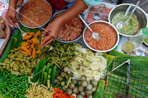 Steamed vegetables and dips on a sales stand (Thailand)