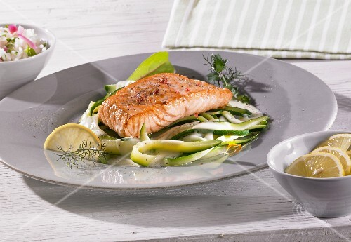 Salmon fillets on courgette pasta