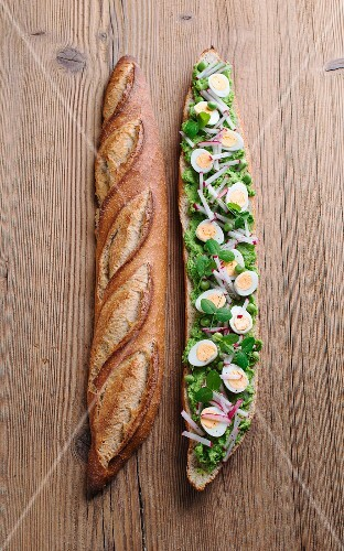 A baguette with avocado and pea cream