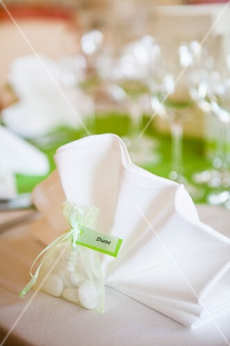 Packet of sweets used as name tag on wedding dinner table