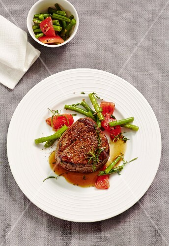 Bison fillet steak with a bean and tomato medley
