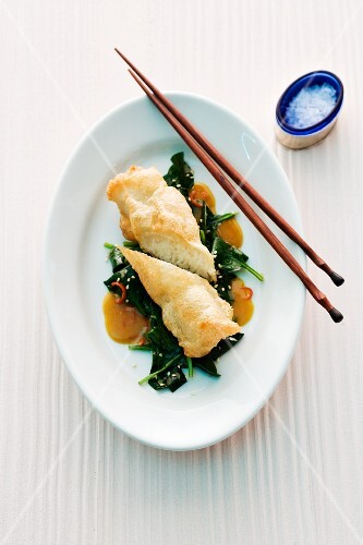 Fried rice rolls on leafy greens (Asia)