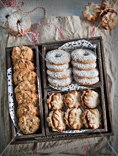 Chocolate chip cookies, Melting Moments and spiced biscuits in a wooden crate
