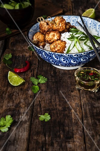 Prawn and chicken meatballs with rice and chilli sauce (Asia)