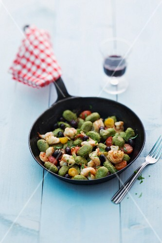 Olive gnocchi with prawns and cherry tomatoes