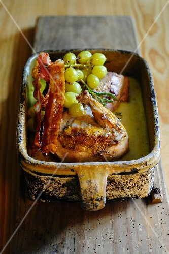 Roasted pheasant with bacon and grapes