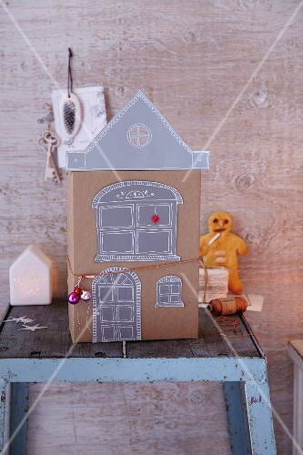A homemade paper house and a bread man for Christmas
