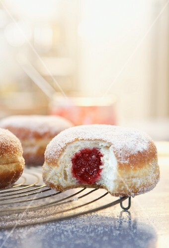 Jam doughnuts on a wire rack