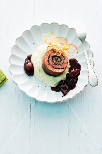 Beef roulade on mashed potatoes with red wine shallots