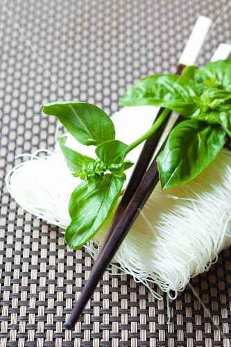 Rice noodles, basil and chopsticks