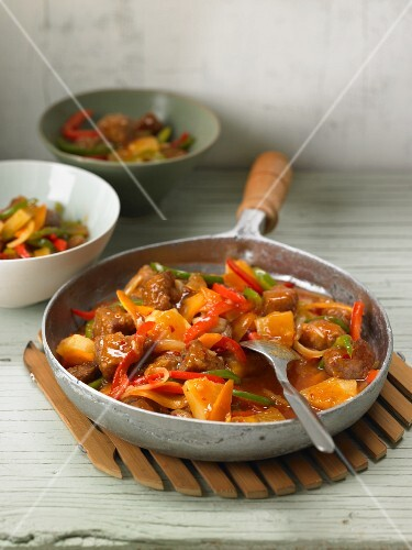 Sweet-and-sour pork with peppers and pineapples