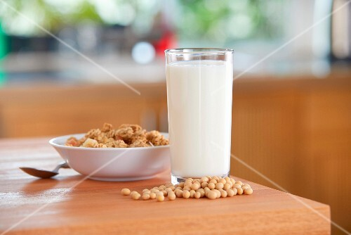 A glass of soya milk, soya beans and cereals