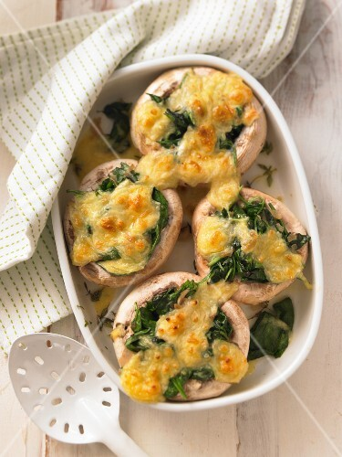 Gratinated mushrooms filled with spinach and cheese