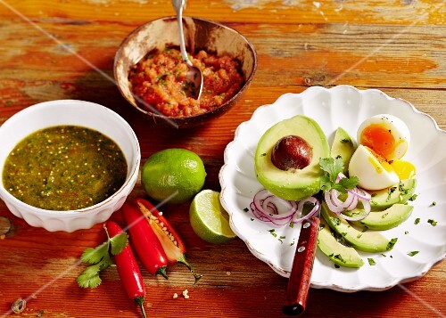 Avocado with red and green salsa