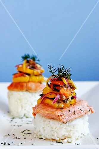 Poached salmon fillet served on rice with pickled vegetables