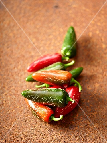 Various different coloured chilli peppers