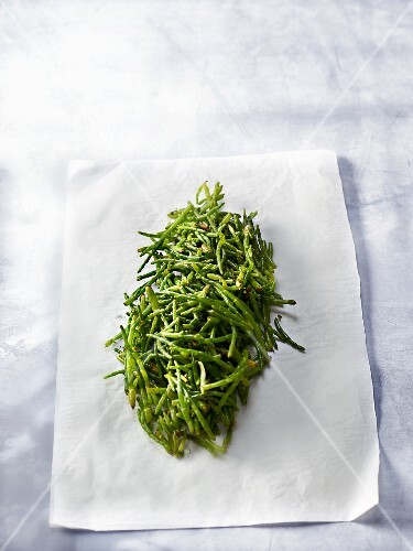 A pile of samphire on a piece of paper