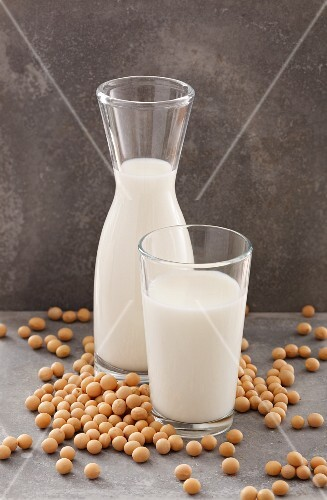 Soya milk in a carafe and in a glass