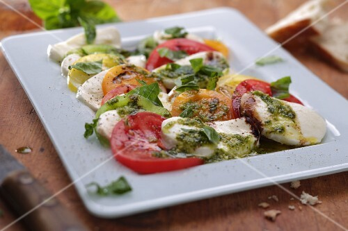 Tomatoes with mozzarella and basil