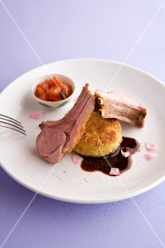 Saddle of milk-fed lamb with a potato cake and tomato and rose coulis
