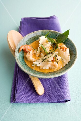Lobster ravioli and king prawns in lemongrass soup