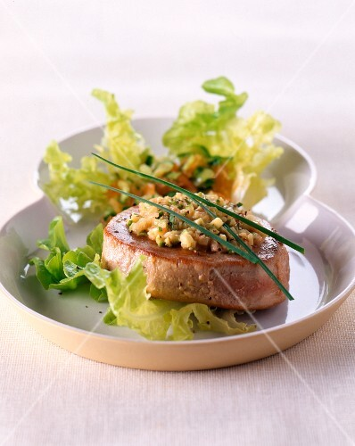 Tuna fish fillet on a mixed leaf salad