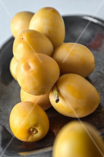 Fresh dates in a silver dish