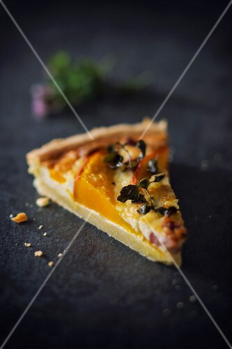 A slice of pumpkin quiche with bacon and Parmesan cheese