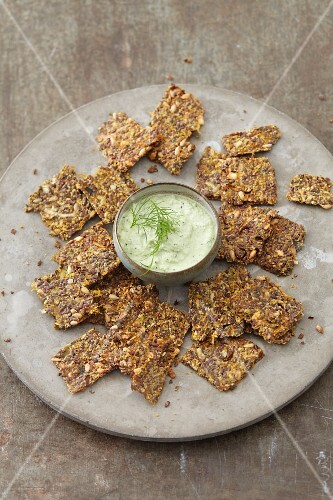 Vegan sunflower crackers with an almond and algae dip