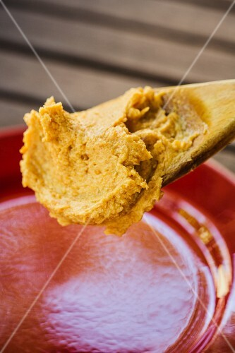 Miso butter on a wooden spoon