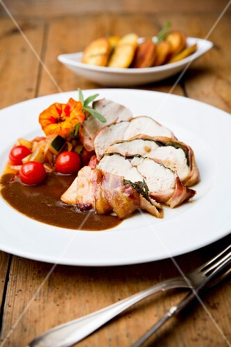 Chicken saltimbocca with cherry tomatoes and roast potatoes