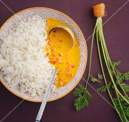 Rice with a carrot and pepper sauce