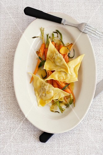 Rabbit ravioli with a carrot and ginger medley