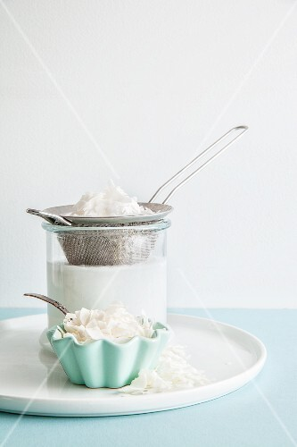 Homemade coconut milk with coconut flakes
