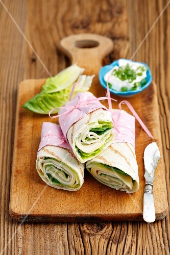 Wraps with cheese, lettuce, cucumber and turkey ham