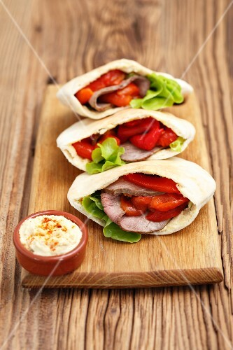 Pita pockets with roast beef and roasted peppers served with hummus