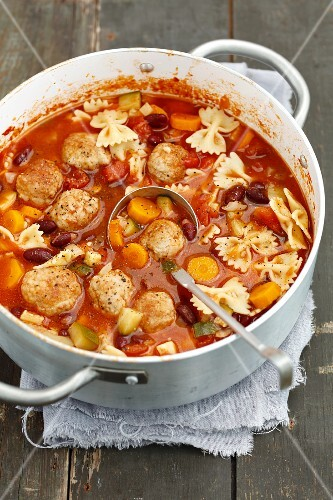 Minestrone with meatballs and farfalle