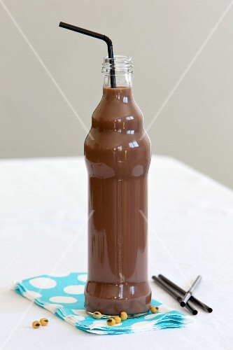 A small bottle of chocolate soya milk with a straw