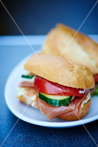 A ham sandwich with cucumber and tomato