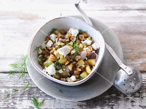Vegetarian fried potatoes with nuts and sheep's cheese