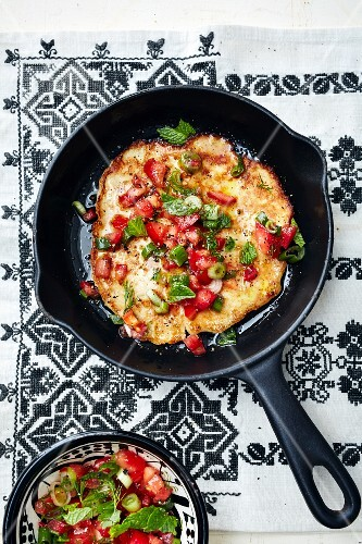 Bulgur pancake with tomato salad (Turkey)