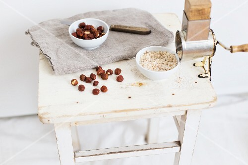 Hazelnuts and a nut grinder with ground hazelnuts