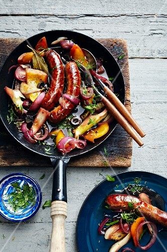 Lamb sausages with vegetables braised in red wine (Turkey)