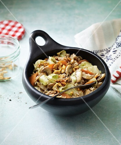 Fried rice with cashew nuts, white cabbage and mushrooms