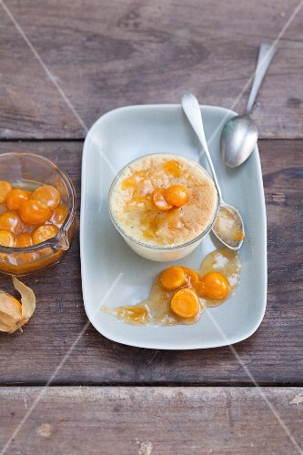 White chocolate souffle with physalis sauce