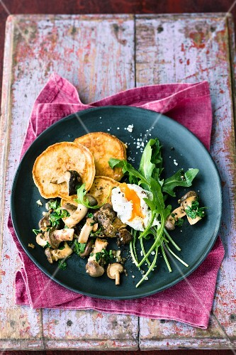 Fried wild mushrooms with quark cakes and poached egg