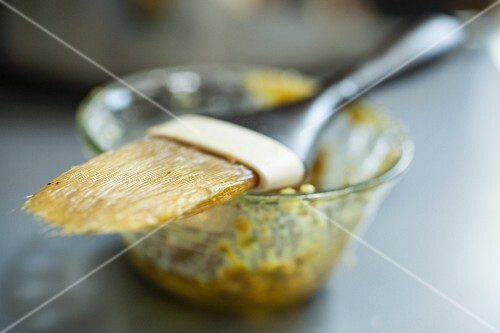A mustard marinade with a brush