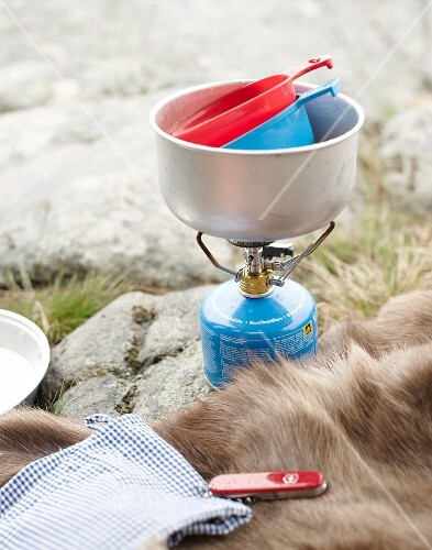Camping utensils on rocky ground