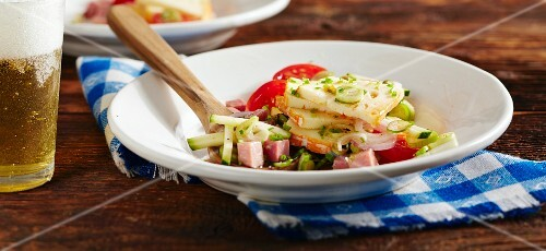 Wine cheese salad with ham and tomatoes